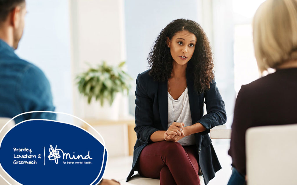 A couple in a relationship counselling with a counsellor