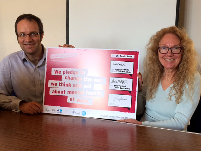 Ben Taylor and Linda Gabriel holding the signed Time to Change Pledge