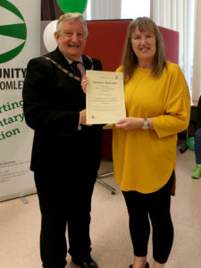 Liz collects her Volunteer Award from the Mayor of Bromley