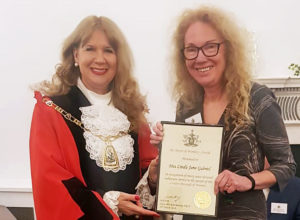 Cllr Kim Botting presenting award to Linda Gabriel