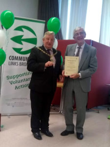 Bernard receives his award from the Mayor of Bromley