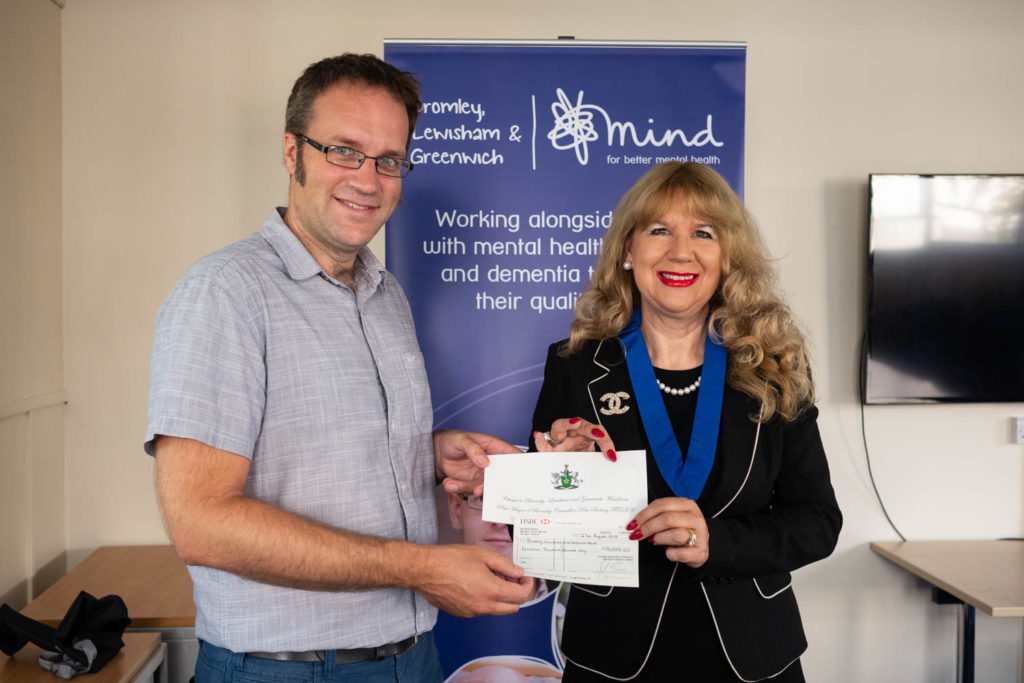 Ben Taylor, Chief Executive of BLG Mind, receives a cheque for £15,000 from Cllr Kim Botting