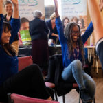 Women talking part in exercise workshop at Bromley World Mental Health Day 2019 event